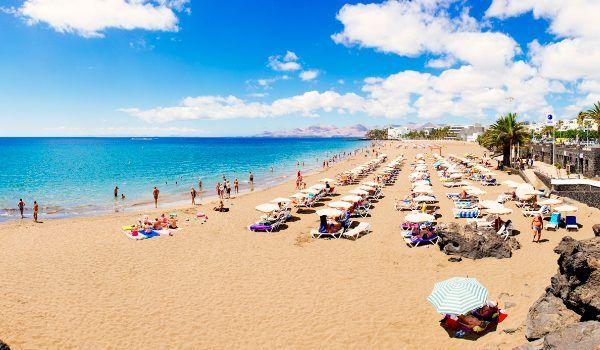 Sunbathing at Puerto del Carmen Lanzarote OK